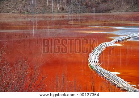 Pollution Of A Lake With Contaminated Water From A Gold Mine.