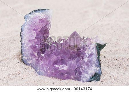 Amethyst Rock On Sand Background