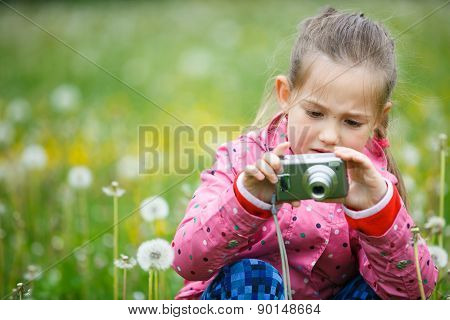 Little Girl Photographing With Her Camera