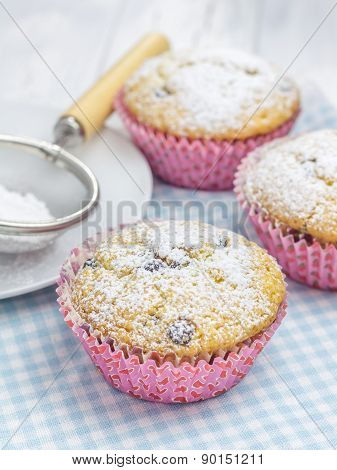 Homemade Muffins With Choco Chips, Decorated With Sugar Powder