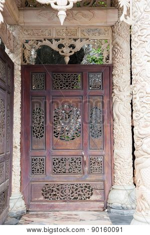 Carved Door With Carved Columns And Portico