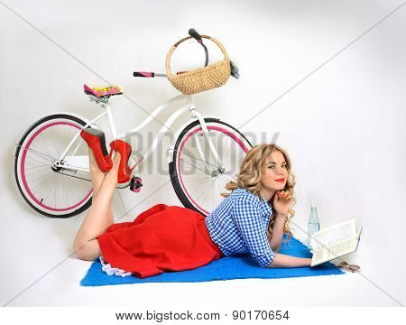 Girl with a bicycle in a retro style