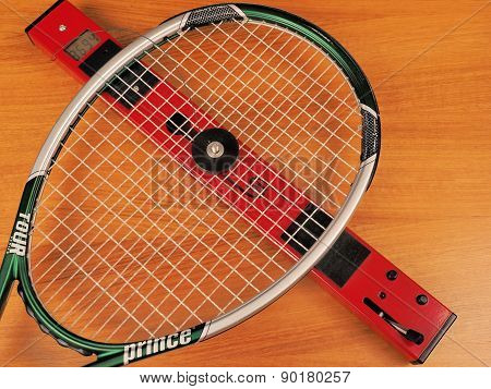 String bed stiffness of a Tennis tour player frame is measured