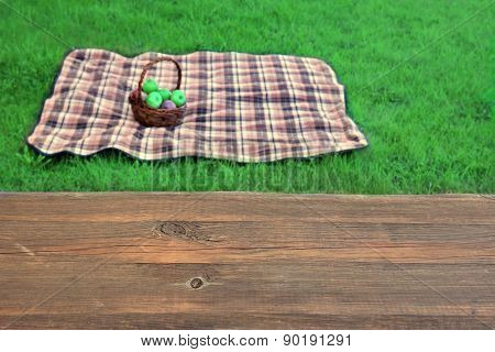 Empty Picnic Table Close-up Blanket With Basket In The Background