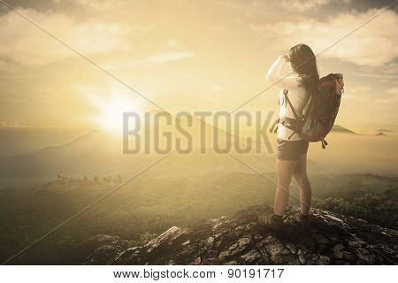 Hiker Enjoying Sunrise View On Mountain