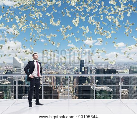 Confident Handsome Businessman Is Standing On The Roof Terrace In New York City. Falling Dollar Note
