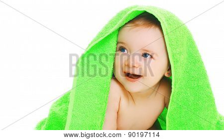 Closeup Protrait Of Cute Smiling Baby Under The Bright Green Towel On A White Background