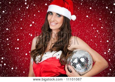 Woman In Santa Costume Holding Disco Ball