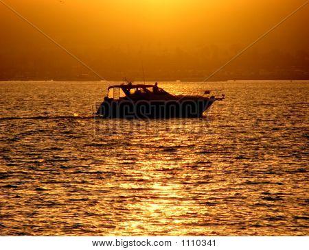 Pleasure Boat At Sunset