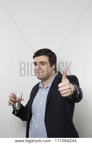 happy businessman drinking water