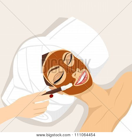 woman having chocolate mask treatment therapy