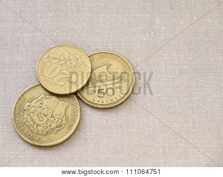 Greek Drachma Coins On The Canvas Background