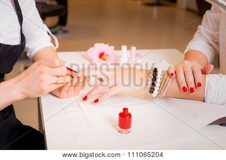Female doing manicure