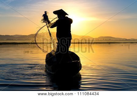Fishermen in action when fishing in the lake, still life and lifestyle.