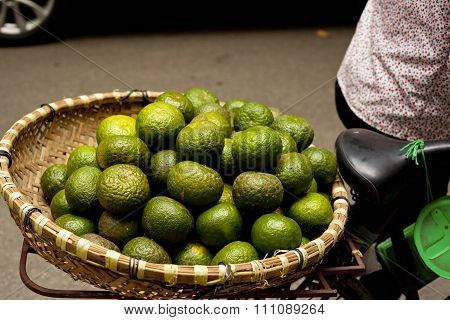 Basket of limes on back of bicycle in Vietnam