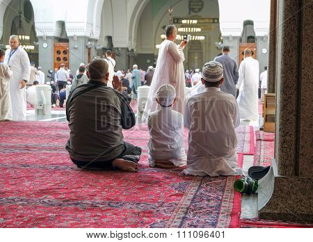 Father And Children Praying In Mosque
