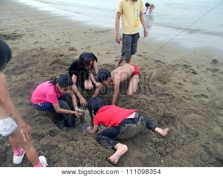 Children Play in the Sand