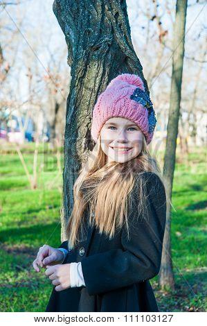 Little Girl Standing Near Tree Cold Season