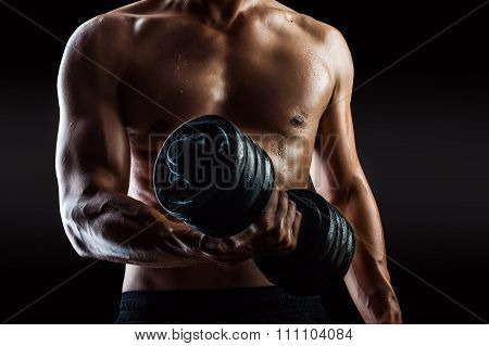 Bodybuilder With Beads Of Sweat Training In Gym.