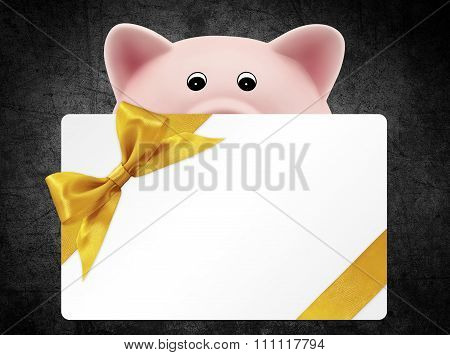 Card Gift With Piggy Bank, Golden Ribbon Bow, Isolated On Black Background