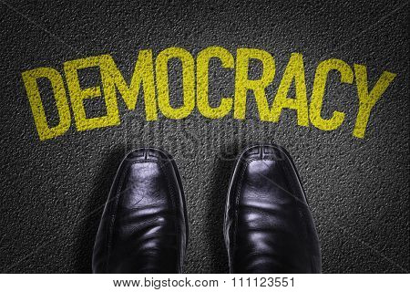 Top View of Business Shoes on the floor with the text: Democracy
