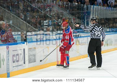 MOSCOW - MARCH 19, 2015: Referee removes Igor Makarov (86) on hockey game Yokerit vs CSKA on Russia KHL championship in the sports complex CSKA Moscow, Russia. CSKA won 4: 2