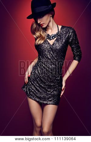 Fashion portrait woman,sequins dress black hat red