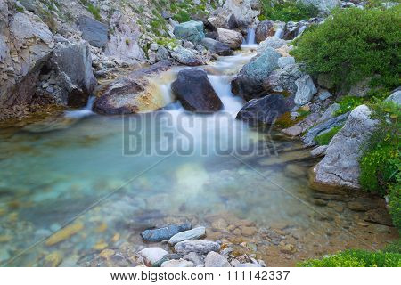 Wild Flowing Waters In The Alps, Long Exposure, Close Up