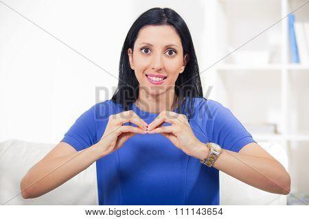 Beautiful smiling deaf woman using sign language