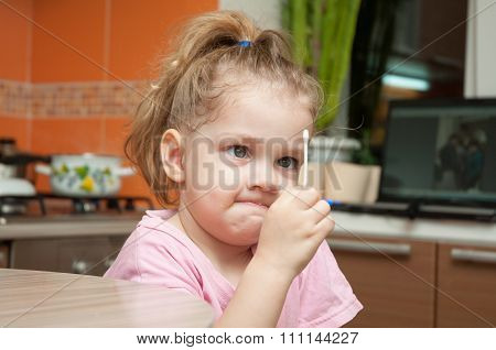 Girl With A Funny Looking Angrily At A Cotton Swab
