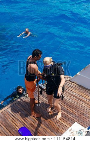Scuba Diving Instructor Checking Equipment