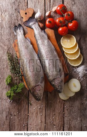Raw Rainbow Trout With Ingredients On A Table. Vertical Top View