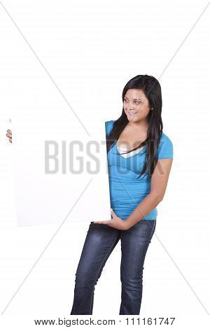 Hispanic Teenager Holding A Blank Sign