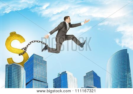 Man jumping over gap with dollar sign ballast