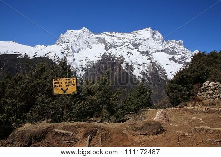 Signboard And High Mountain