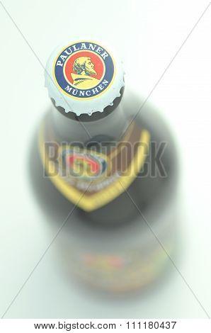 Paulaner dunkel beer isolated on white background