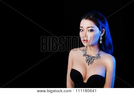 Beautiful sexy brunette asian woman with jewelry.