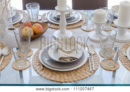 Table Set On Glass Dinning Table In Dinning Room