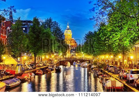 Westerkerk (western Church), With Water Canal View In Amsterdam. Netherlands.