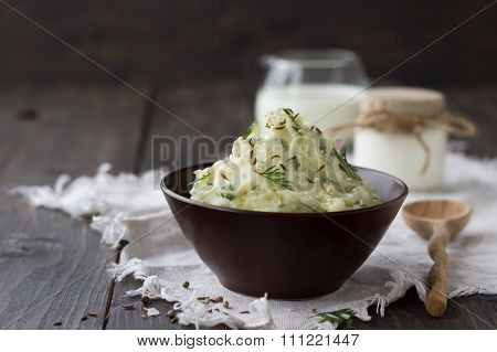 Mashed Potatoes With Yogurt, Tehina, Cilantro And Spices In A Ceramic Bowl On A Wooden Table