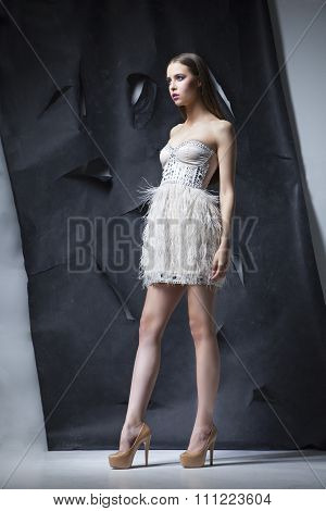 girl posing in cocktail white dress with bahram