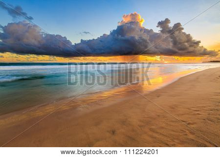 Seascape With Dark Rain Clouds At Sunset