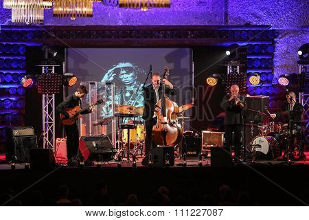 WIELICZKA POLAND - NOVEMBER 2 2015: Adam Kawonczyk Quartet playing live music at The Cracow Jazz All Souls' Day Festival in The Wieliczka Salt Mine. Poland