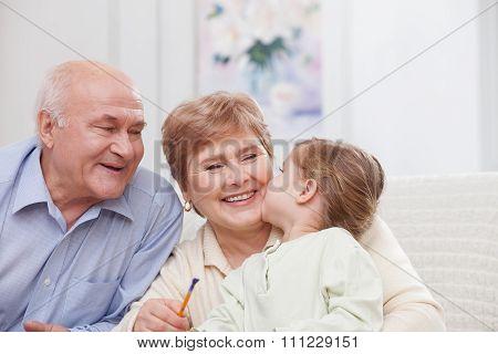 Pretty grandparents are taking care of child