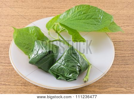 Plate Of Betel Leaf Wrapped Bite Size Appetizer
