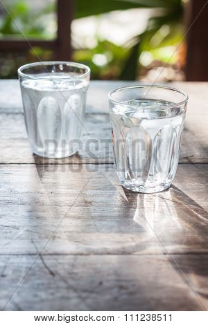 Glasses Of Cold Water On Wooden Table