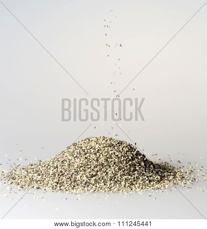 Black Pepper Grains Falling Into Pile