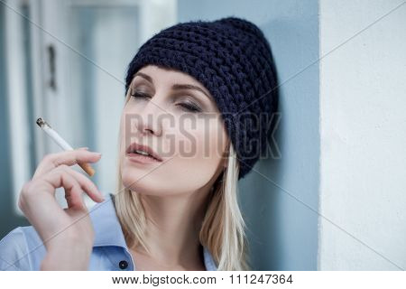 Young female drug addict is enjoying unhealthy narcotic
