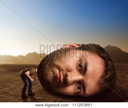 Man with enormous head in the desert