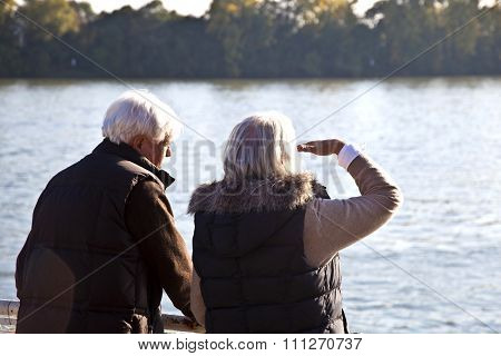 Couple Watching The Nature At The River